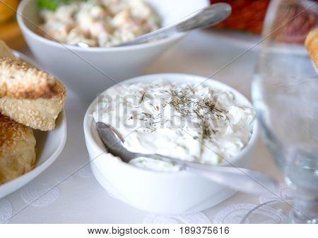 Tzatziki Sauce. Greek Yogurt Cucumber Dip In White Bowl Over Table.