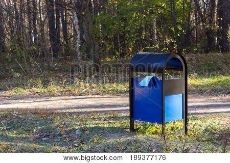 trash bin in a park. ecology concept
