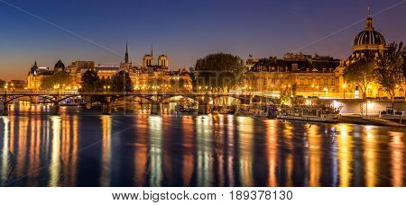 Dawn on Ile de la Cite and the Seine River with view on the French Institute and Pont des Arts. 4th and 6th Arrondissements. Paris France