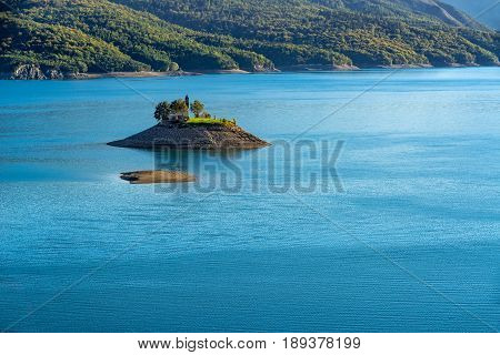 Saint-Michel Chapel and Serre-Poncon Lake in summer. Saint-Michel Bay Hautes-Alpes PACA Region Southern French Alps France