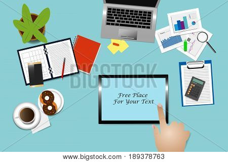 Top view of office desk with supplies coffee cup and donuts on the plate. Hand is touching tablet with free place for your text.