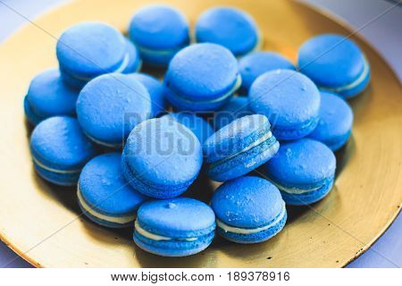 Beautiful blue decorated candy table baked sweet tasty cupcake cupcakes on a party, beautifully decorated catering banquet table with blue colored candy sweet delicacy