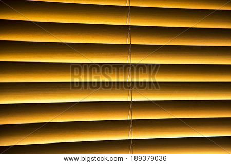 A home interior blind with wooden slats
