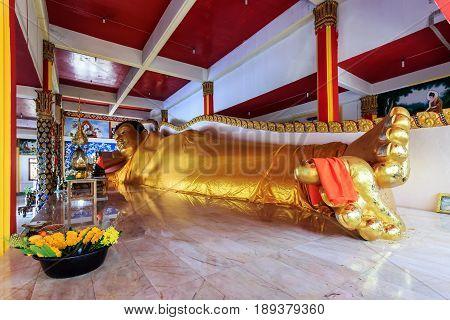 Reclining Golen Buddha Statue In Wat Koh Sirey