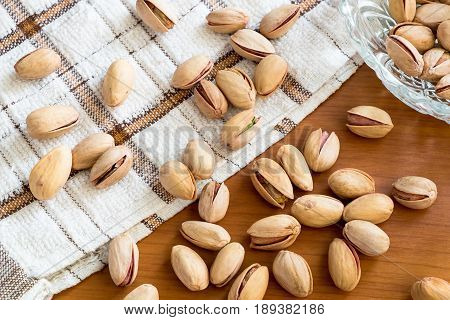 pistachios seed nut on the wooden table healthy pistachios nuts with nature tasty.