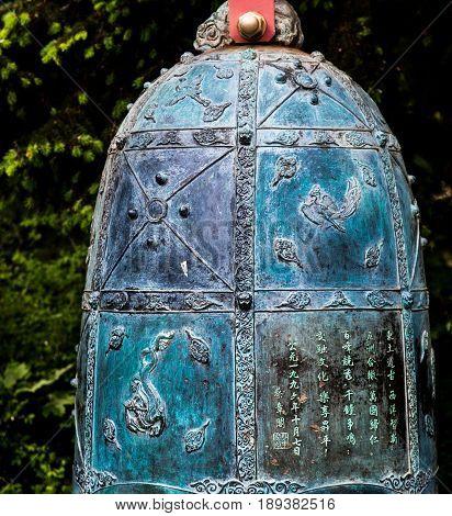 An Ornate Bell in a Japanese Garden