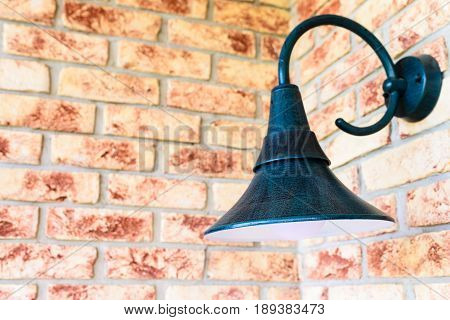 Retro wall lamp - vintage sconce - on the brick wall