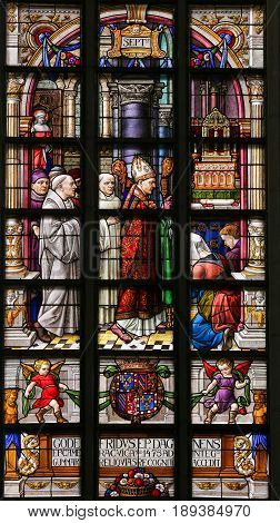 Stained Glass - Bishop And Priests In The Church Of St Gummarus
