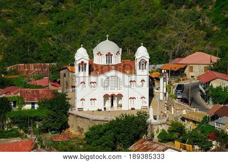 White church in Pedoulas village Troodos mountains