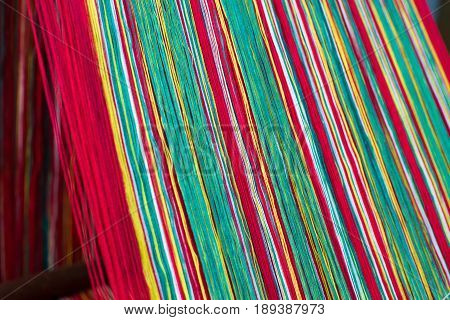 Colored weaving yarns on a handloom in Sikkim, India
