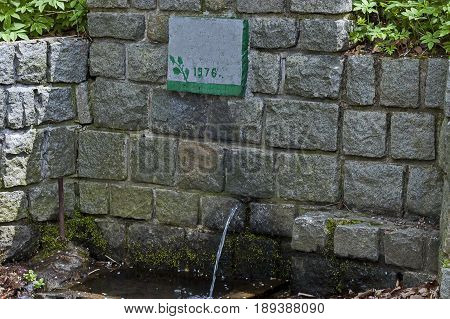 Fresh water gush from  old fountain in the Plana mountain, Bulgaria