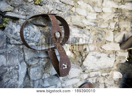 Varenna Italy - May 9 2017: Lake of Como ancient Chastity belt exposed to the castle of Vezio