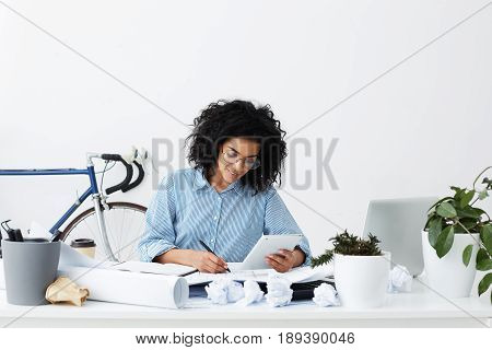 People, Occupation And Modern Technology Concept. Beautiful Skilled Female Designer Using Touch Pad