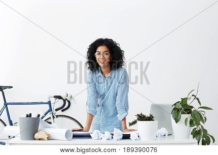Smiling Dark-skinned Afro American Woman Having Voluminous Dark Hair Wearing Big Round Glasses And B
