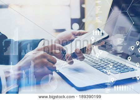 Closeup view of Male hand pointing finger on smartphone touch screen.Businessman working at office on modern notebook.Concept of digital diagram, graph interface, virtual screen, connection icon.Blurred