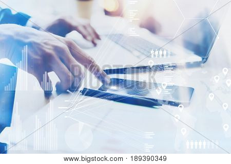 Closeup view of Male hand pointing finger on mobile phone touch screen.Businessman working at office on modern notebook.Concept of digital diagram, graph interfaces, virtual screen, connections icon