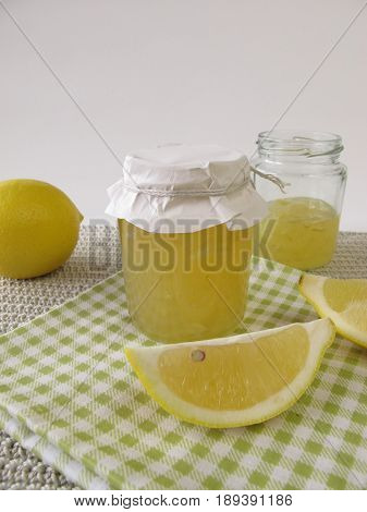 Homemade lemon marmalade in jar and fresh fruits poster
