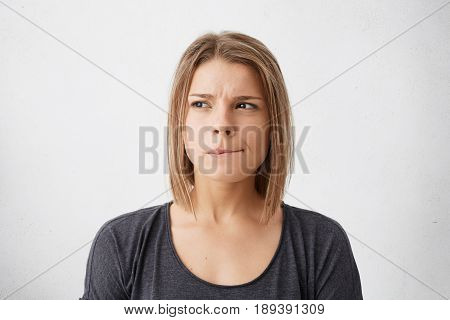 Close Up Portrait Of Beautiful Young Woman With Bob Hairstyle Biting Her Lips And Looking Sideways W