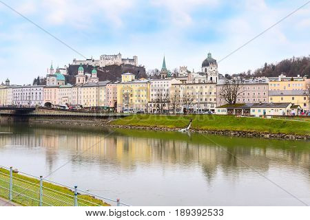Salzburg, Austria - December 25, 2016: Historic city of Salzburg with Cathedral and Hohensalzburg Festung castle across Salzach river