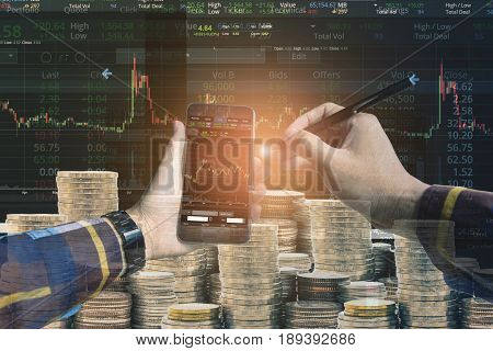 Double exposure of Hand holding blank smart phone checking financial stats on screen with group of coins and stock background for trading stock concept.