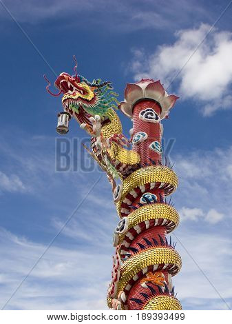 Chinese dragon statue. Dragon statue, Chinese dragon on the blue sky