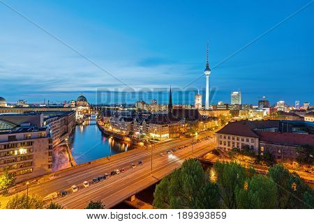 The skyline of Berlin with the Television Tower at dusk