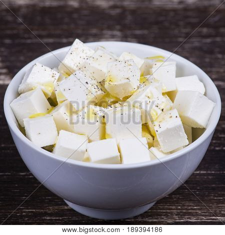 White greek cheese in plate on the table. Close up