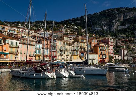 Villefranche-Sur-Mer Harbour France 09 May 2017 - Cote d'Azur - French Riviera - Moored boats hotels and the hill
