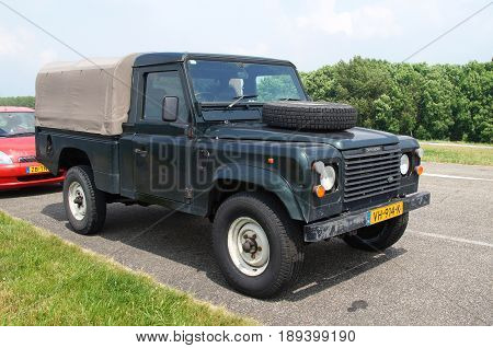 Almere Poort, Flevoland, The Netherlands - June 3, 2017: Land Rover 110 Defender 4C Diesel parked by the side of the road in the city of Almere. nobody in the vehicle