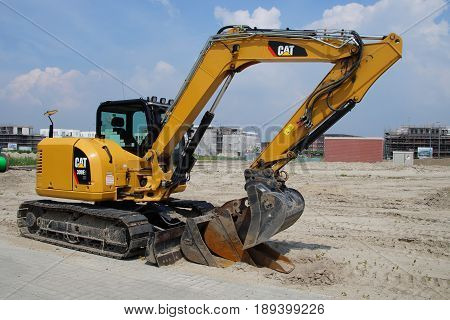 Almere Poort, Flevoland, The Netherlands - June 3, 2017: Yellow Cat 308E2 CR Mini Hydraulic Excavator in the city of Almere Poort. Nobody in the Excavator.