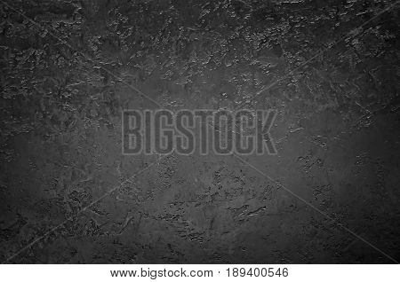 Grunge black background from sheet metal. Dark metal texture.