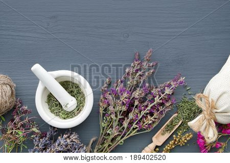 Bunches Of Healing Herbs, Mortar And Sachet On Board. Herbal Medicine. Top View, Flat Lay.