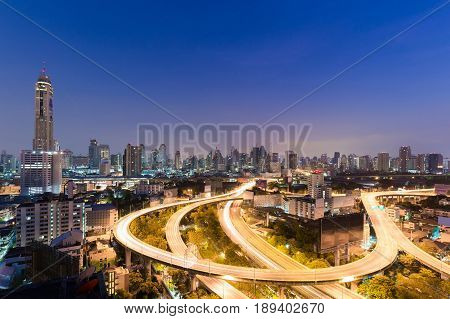 Twilight aerial view highway interchanged and city downtown background night view Bangkok Thailand