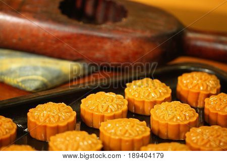 Mooncake,dessert for Chinese mid autumn festival, background, food stylish, menu decoration, wallpaper, yellowish dessert, historical dessert