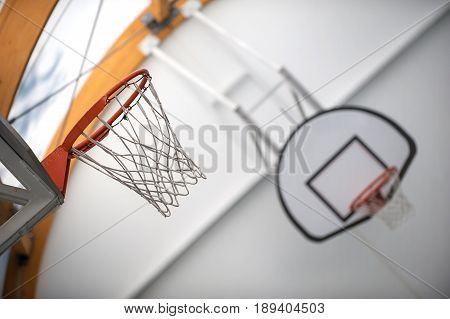 Two Basketball Hoops In Sport School Gym Hall