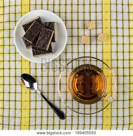 Waffle Cake In Saucer, Teaspoon, Sugar And Cup Of Tea