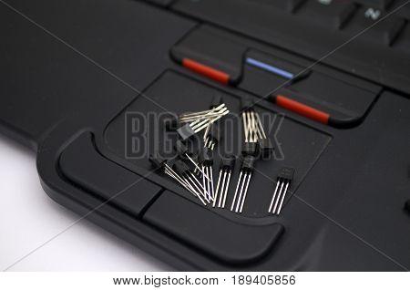 Transistors arranged on a laptop touch mouse