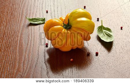 Heirlooms оrganic yellow tomatoes with basil and olive oil