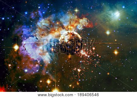 Spaceship in outer space against the background of the nebula. Elements of this image furnished by NASA.