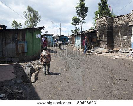 KIBERA, KENYA-NOVEMBER 5, 2015: Unidentified people live and work in Kibera, Africas largest urban slum.