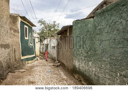 HARAR, ETHIOPIA-MARCH 26, 2017: Unidentified woman walks the colorful walled streets of Harar, Ethiopia