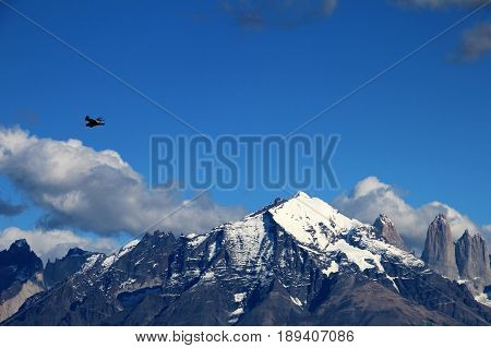 Andean condors fly in Parque Nacional Torres del Paine in Chile