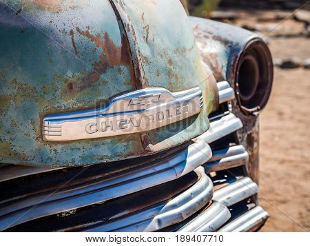 SOLITAIRE NAMIBIA - JUNE 18 2016: Old Chevrolet car wreck left in Solitaire on the Namib Desert Namibia.
