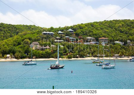 Antigua, Caribbean islands, English Harbour - May 20, 2017:  English harbour view with Freeman's bay and yachts anchored by the beach