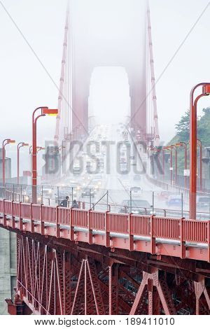 Traffic on Golden Gate Bridge on a foggy day - CALIFORNIA
