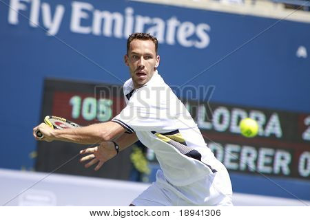 TORONTO- AUGUST 12:Michael Llodra plays against Roger Federer in the Rogers Cup 2010 on August 12, 2010 in Toronto, Canada.