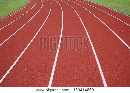 Eight lane track and field that is coming up on a curve