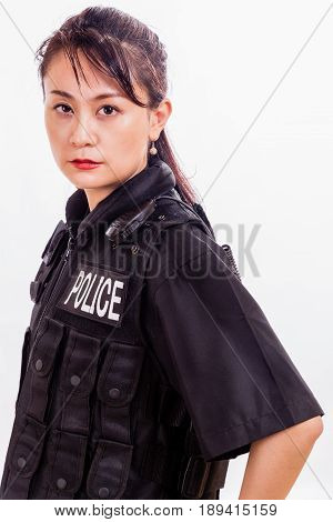 Chinese female police officer, side profile, looking at camera
