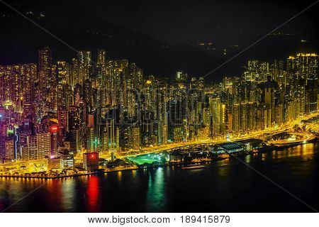 Hongkong hdr aerial cityscape with sunset sun. Amazing panorama of buildings and sky reflecting in harbour