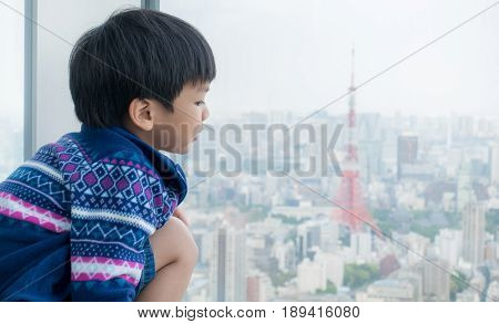 Japanese boy is looking out to Tokyo for future